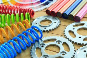 Custom coated gears, springs, tubes
