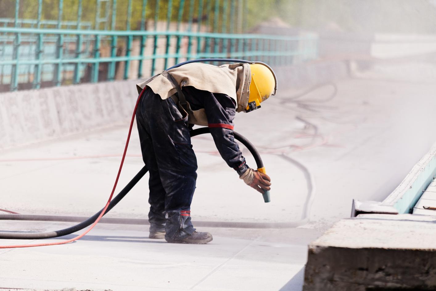 Man sandblasting concrete