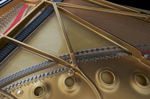 Emralon coating for parts inside a piano