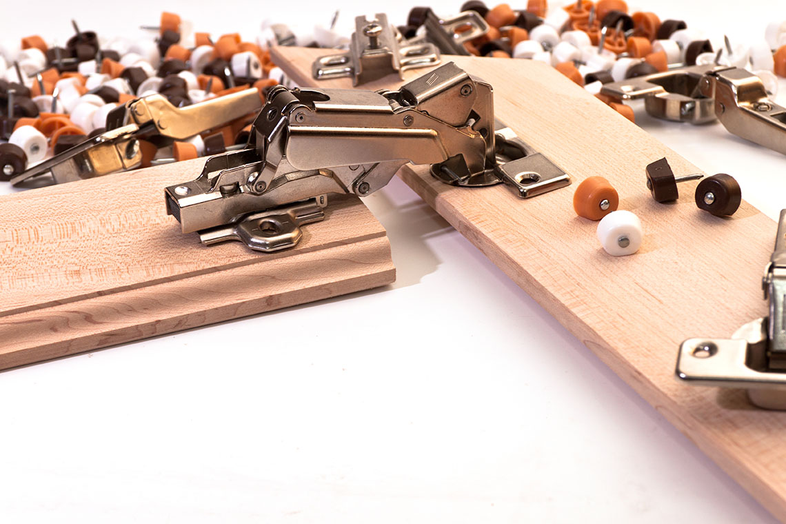 Emralon coatings for wood and metal hinges
