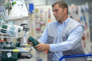 Man placing FEP coating wiring on shelf