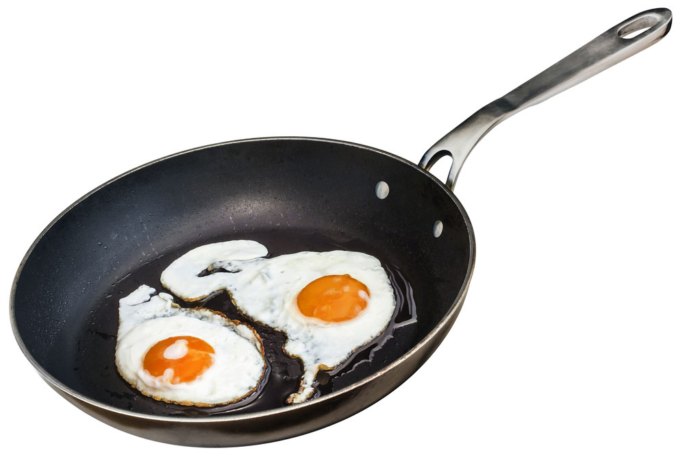 Eggs Cooking in a Teflon Pan