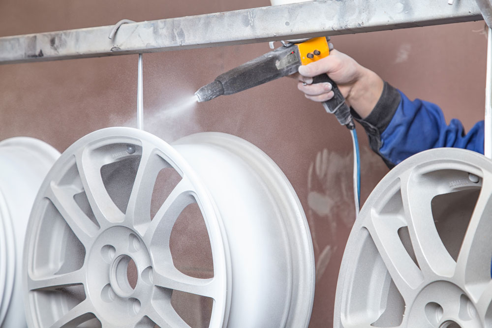 Powder Coating Being Applied to Auto Wheels