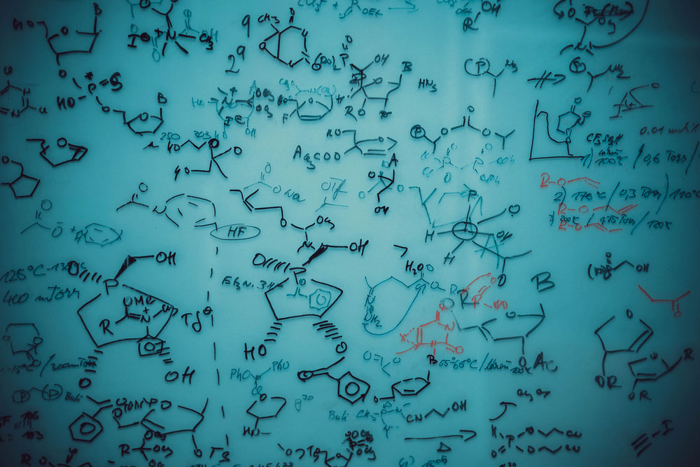 Board with chemical formulas drawn on it