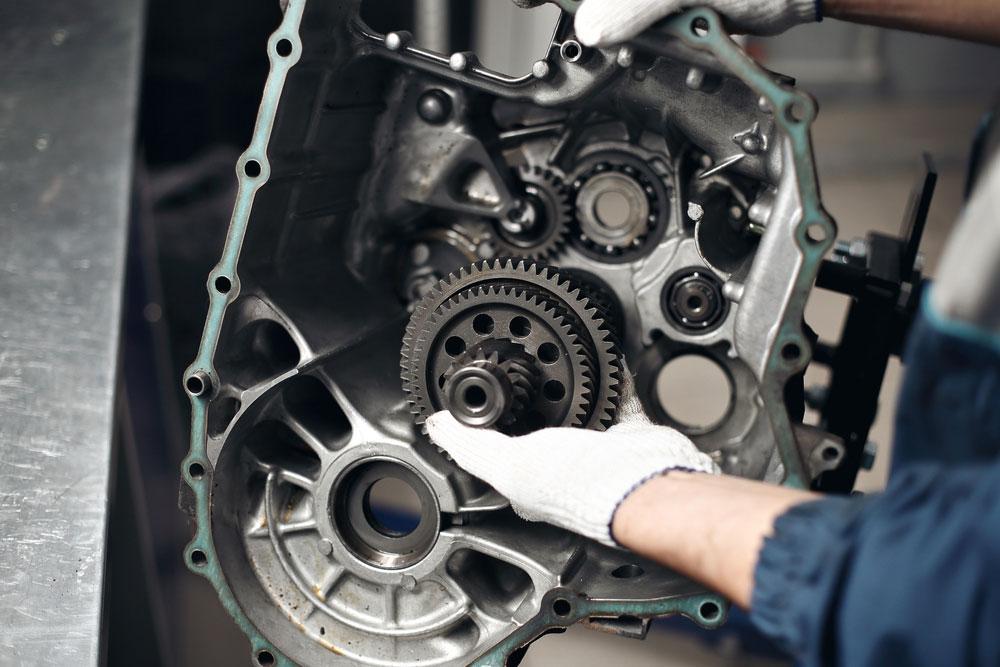 Mechanic working on a gear box
