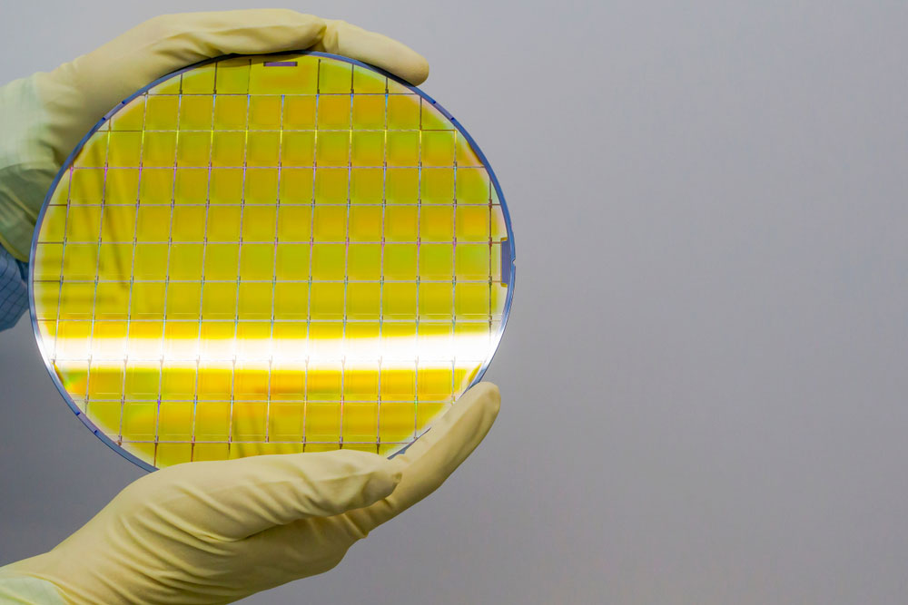 Silicon Wafers Held in Hands