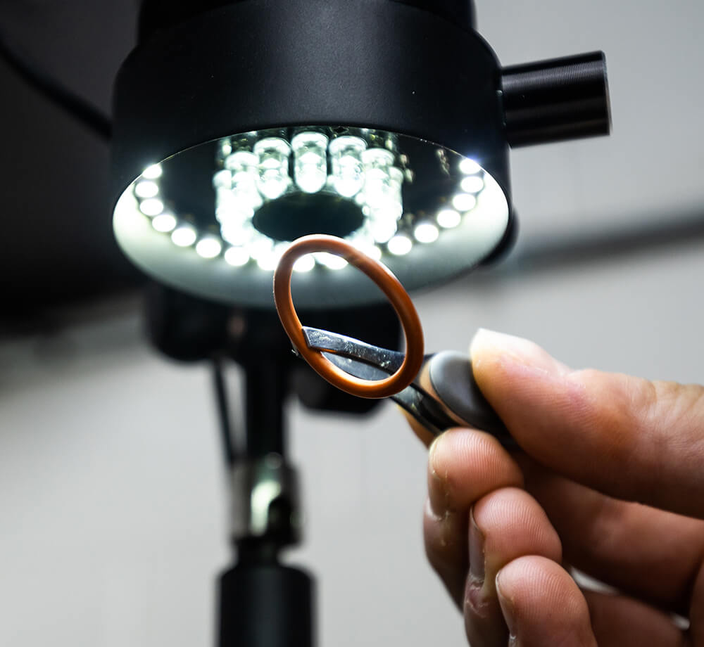 tweezers holding o ring under led light
