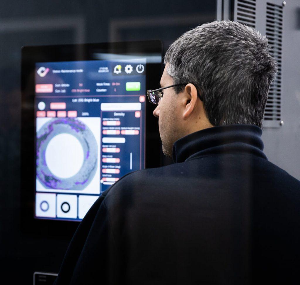 CSI technician using digital touchscreen