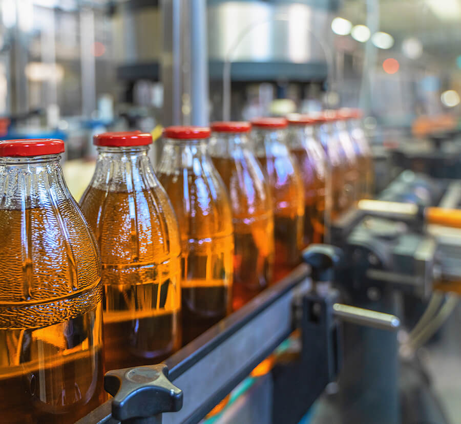 juice bottles on conveyor belt