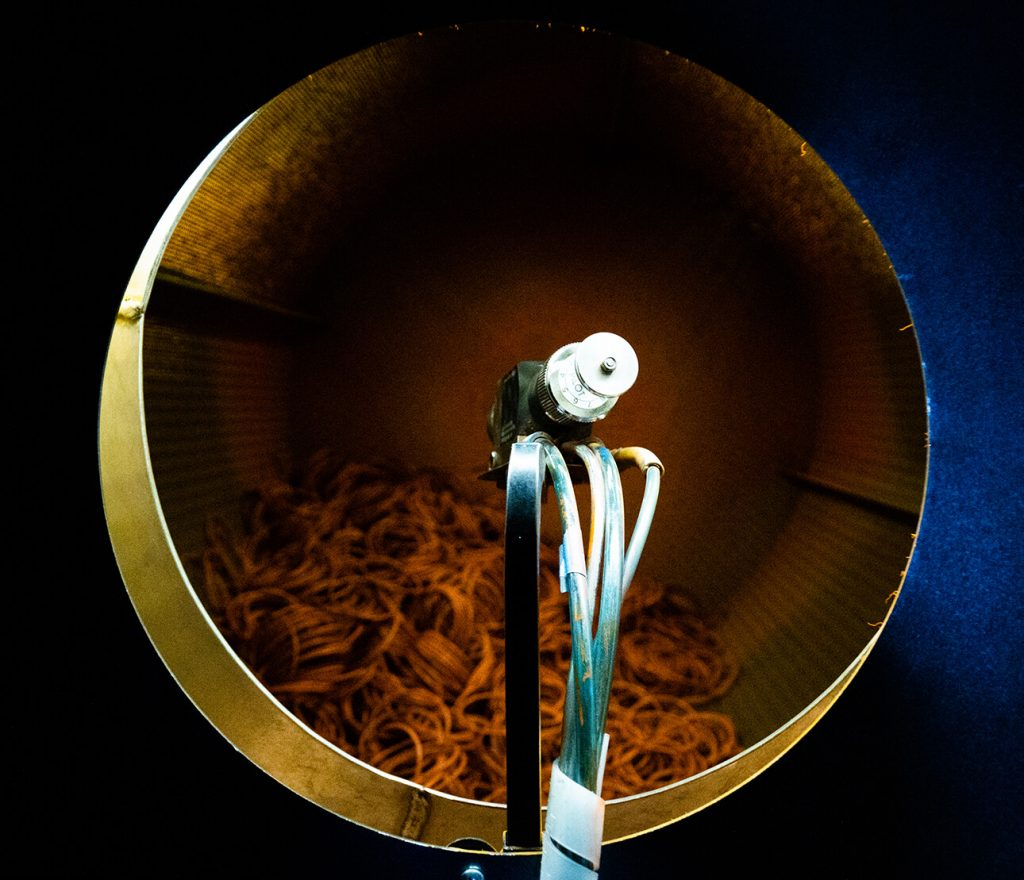 o rings being spray coated in steel drum